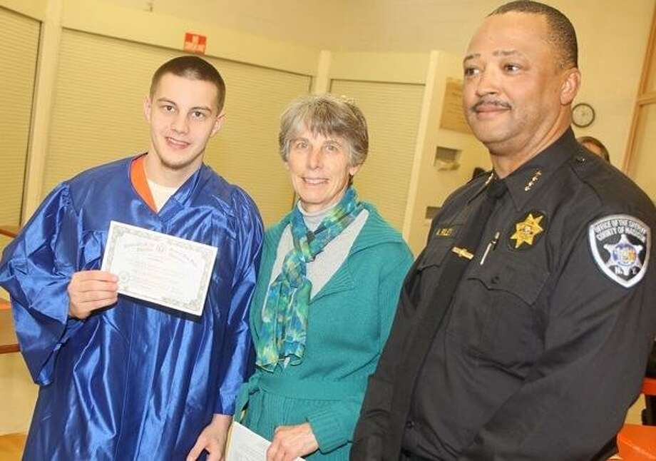 Dispatch Staff Photo by JOHN HAEGER (Twitter: @OneidaPhoto) Madison County Jail inmate Jacob Brown holds his GED as he poses with GED teacher Ellen Beebe and Madison County Sheriff Allen Riley during a graduation ceremony on Tuesday, Jan. 29, 3013 inside the jail in Wampsville.