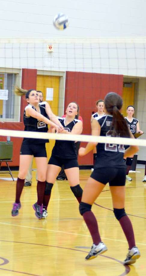Dispatch Staff Photo by KYLE MENNIG Stockbridge Valley's Morgan Rood, left, hits the ball as teammates Justiss Usborne, center, and Meriah Beauvais (21) watch during a match against Remsen.