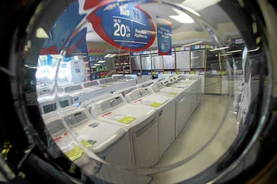 FILE - In this Wednesday, Sept. 18, 2013, file photo, appliances are on display at a Sears store in Berlin, Vt. The Commerce Department reports on business orders for durable goods in October on Wednesday, Nov. 27, 2013. (AP Photo/Toby Talbot, File) Photo: AP / AP