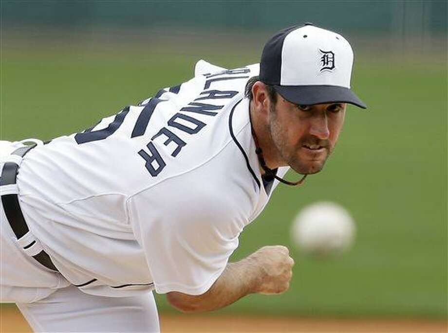 FILE - In this March 11, 2013 file photo, Detroit Tigers starting pitcher Justin Verlander throws during the first inning of an exhibition spring training baseball game against the New York Mets, in Lakeland, Fla. Verlander has agreed to a five-year contract covering 2015-19. (AP Photo/Carlos Osorio, File) Photo: AP / AP