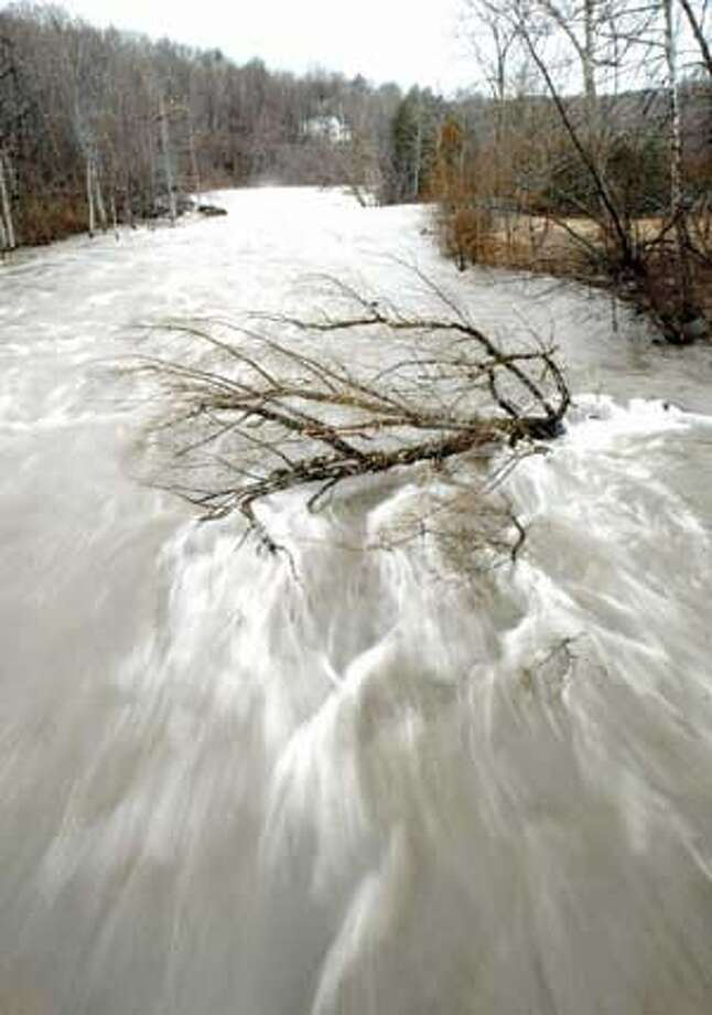 """The Housatonic River churns through Falls Village on Monday. Periods of rain throughout the day added to the already swollen rivers and streams, but the Northwest Corner generally felt less of an impact from the weather than other areas of the state. Purchase a glossy print of this photo and more at <a href=""""http://www.registercitizen.com"""">www.registercitizen.com</a>. MIC NICOSIA/Register Citizen"""
