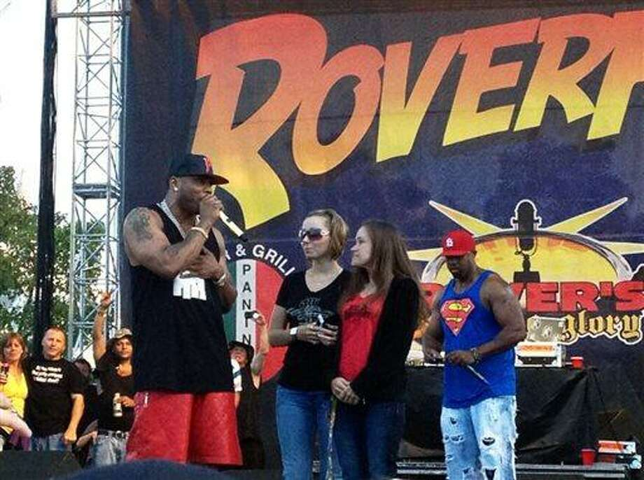 In this Saturday, July 27, 2013, photo provided by Brian Harrell, Amanda Berry, one of three women held captive in a Cleveland home for a decade, makes a surprise appearance at the RoverFest concert in Cleveland. Berry appeared at a public event for the first time since her rescue, a day after her abductor pleaded guilty in the case. The rapper Nelly called Berry back to the stage after his music set. (AP Photo/Courtesy Brian Harrell) Photo: AP / Brian Harrell