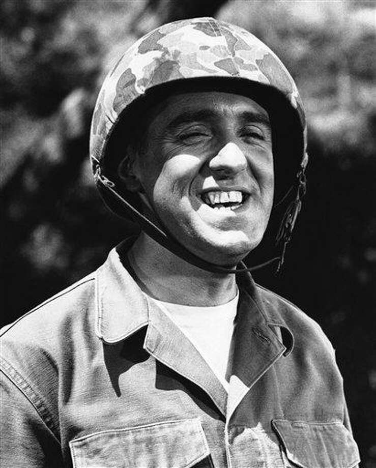 FILE - Jim Nabors is seen in character for his role of Gomer Pyle in this 1966 file photo. Hawaii News Now reports Jim Nabors and his partner, Stan Cadwallader, traveled from their Honolulu home to Seattle to be married Jan. 15, 2013. The couple met in 1975 when Cadwallader was a Honolulu firefighter. The 82-year-old Nabors says you've got to solidify something when you've been together as long as they have. (AP Photo) Photo: AP / AP