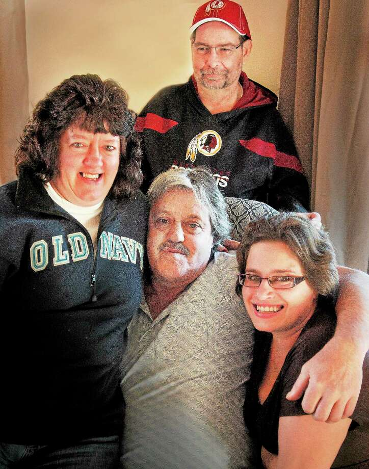 Clockwise from bottom center: Ron Harrington; his sister, Shirley Reilly; brother-in-law, Gary Reilly; and neice, Kelli Harrington. Photo: Melanie Stengel — New Haven Register