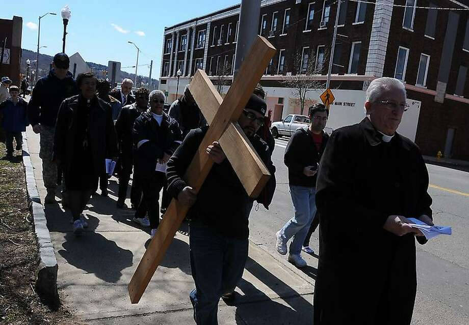 The fifth annual Good Friday Ecumenical Service Way Of The Cross t on Main Street in Ansonia Friday, March 29, 2013. People from various churches walk up Main Street from Veterans Park to the Ansonia Armory, stopping along the wan to mark the final hours of Jesus' life. Photo by Peter Hvizdak / New Haven Register. Photo: New Haven Register / ©Peter Hvizdak /  New Haven Register