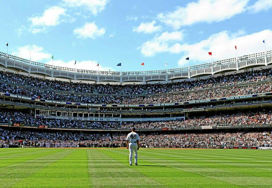 Yankees manager Joe Girardi says he's thinking about letting closer Mariano Rivera play in the outfield during the season-ending series in Houston. Photo: Elsa Garrison — The Associated Press   / Getty Images, Pool