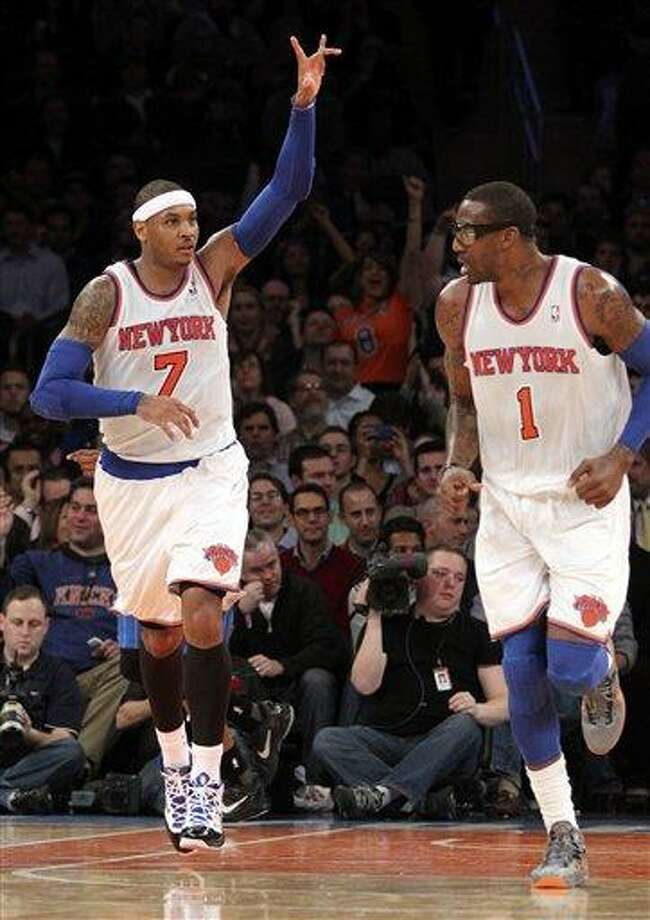 New York Knicks' Carmelo Anthony (7) and Amar'e Stoudemire react after Anthony scored a basket during the second half of NBA basketball game against the Orlando Magic, Wednesday, Jan. 30, 2013, at Madison Square Garden in New York.  The Knicks won 113-97.(AP Photo/Mary Altaffer) Photo: ASSOCIATED PRESS / AP2013