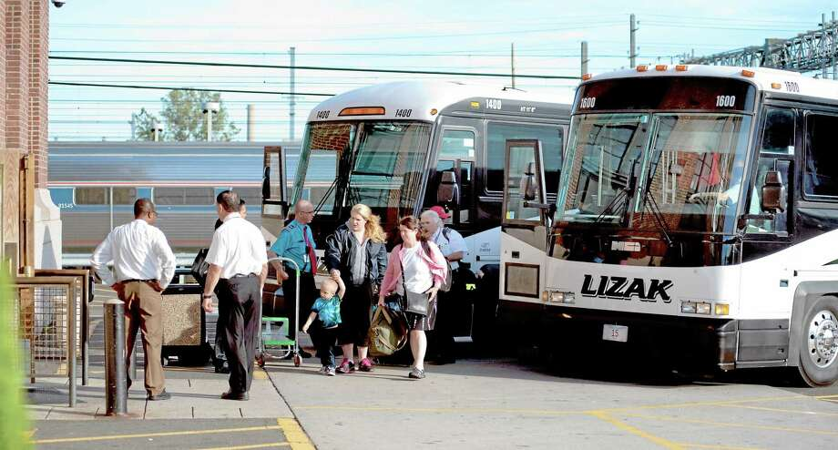 Passengers disembark from Lizak Tour buses at Union Station in New Haven to make their train connection from Hartford as some train service is expected to be disrupted for days or longer after a 138,000-volt feeder line running from Mount Vernon to Harrison, N.Y., lost power early Wednesday. (VM Williams/Register) Photo: Journal Register Co.