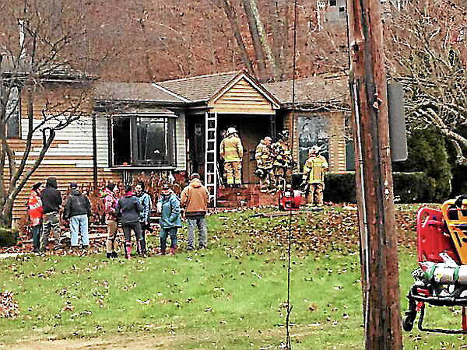 The scene of a house fire on Barberry Road Tuesday. Photo: Evan Lips — New Haven Register