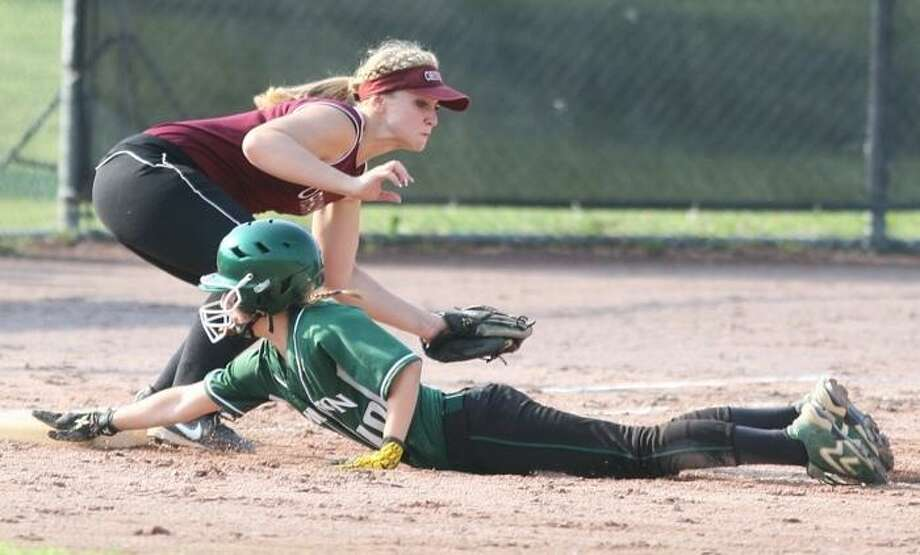 JOHN HAEGER @ONEIDAPHOTO ON TWITTER/ONEIDA DAILY DISPATCH Hamilton's Lauren Weeks (10) slides back to first under the tag of Oriskany's Ashley Rueger (11) in the top of the fourth inning of their Class D semifinal in Rome on Thursday, May 30, 2013. Hamilton won 9-0 to advance to the finals.
