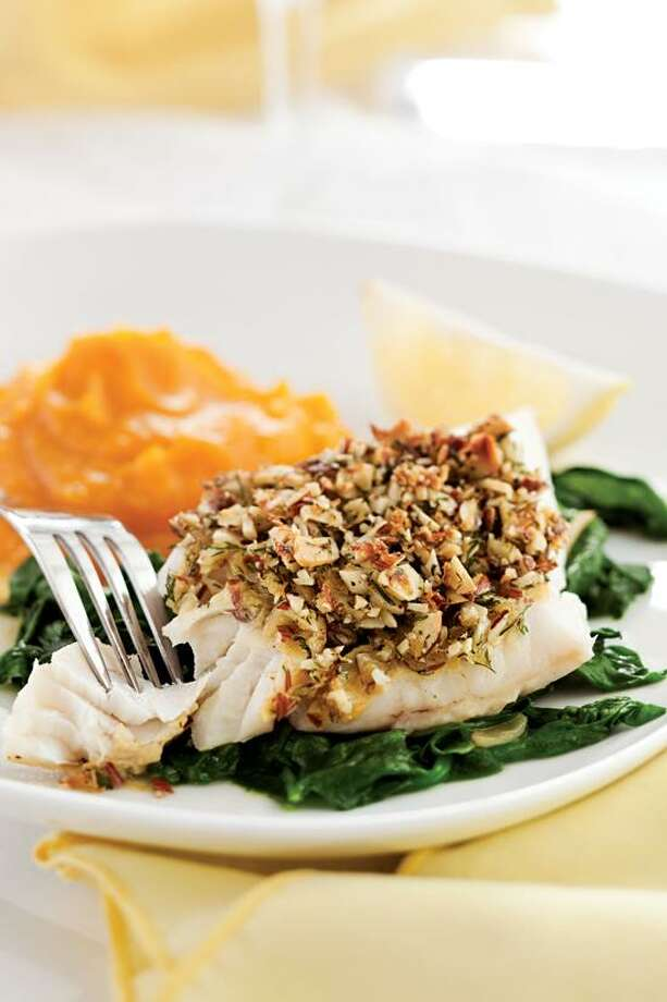 Ken Burris/EatingWell photo: Almond- and Lemon-Crusted Fish With Spinach Photo: Ken Burris/EatingWell