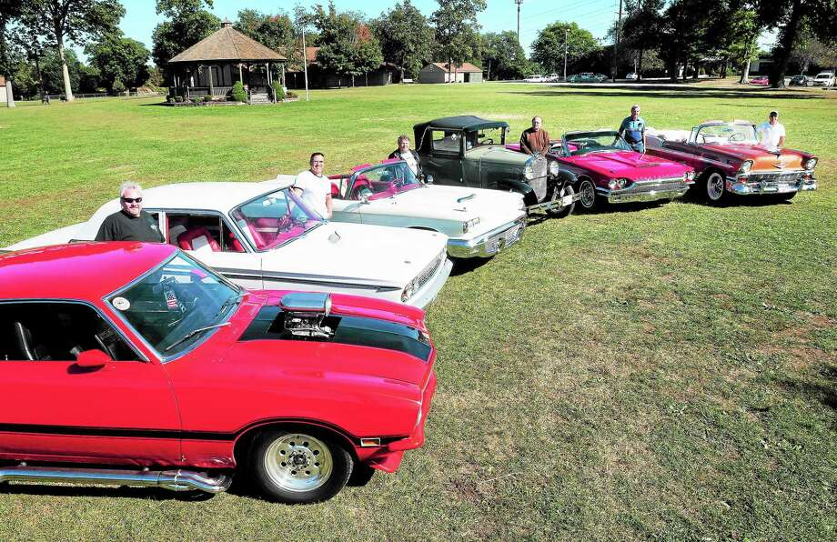 (Arnold Gold — New Haven Register)  Left to right, Will Anjone with his '72 Ford Maverick, A.J. Manno with his '63 Ford Fairlane, Gino Giordano with his '59 Ford Thunderbird, Bob Andrews with his '31 Ford Model A, Ken Nicholas with his '64 Ford Thunderbird Roadster and Mike Pacella  with his '56 Chevrolet Belair Convertible are photographed a the Orange Fairgrounds on 9/25/2013. Photo: Journal Register Co.