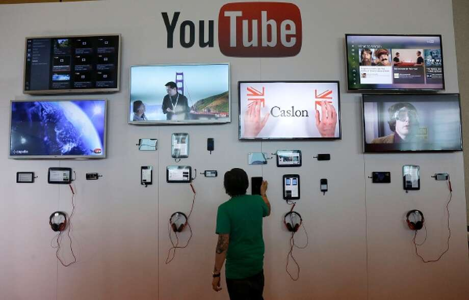 A man looks at a device a the YouTube booth at Google I/O 2013 in San Francisco. Photo: ASSOCIATED PRESS / AP2013