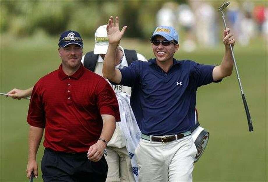 Jason Caron, right, salutes the crowd at the 2006 Honda Classic. (Associated Press)