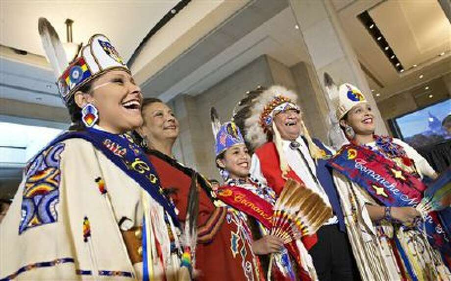 Wallace Coffey, chief of the Comanche Nation in Oklahoma, second from right, and other Comanches laugh Nov. 20 as they take photos before a Congressional Gold Medal ceremony Capitol Hill in Washington. Photo: AP / AP