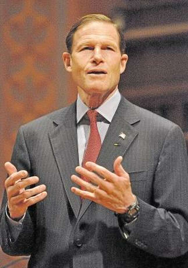 Catherine Avalone/The Middletown Press      U.S Senator Richard Blumenthal-D speaks to Wesleyan students about banning assault weapons Friday evening at Wesleyan's Memorial Chapel. / TheMiddletownPress
