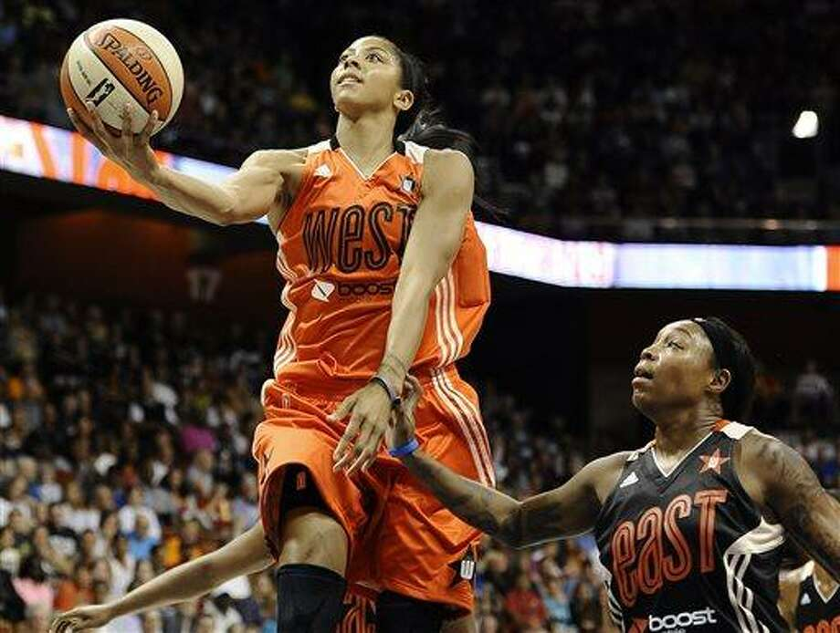 West's Candace Parker, of the Los Angeles Sparks, drives to the basket while guarded by East's Cappie Pondexter, of the New York Liberty, during the first half of the WNBA All-Star basketball game in Uncasville, Conn., Saturday, July 27, 2013. (AP Photo/Jessica Hill) Photo: AP / FR125654 AP