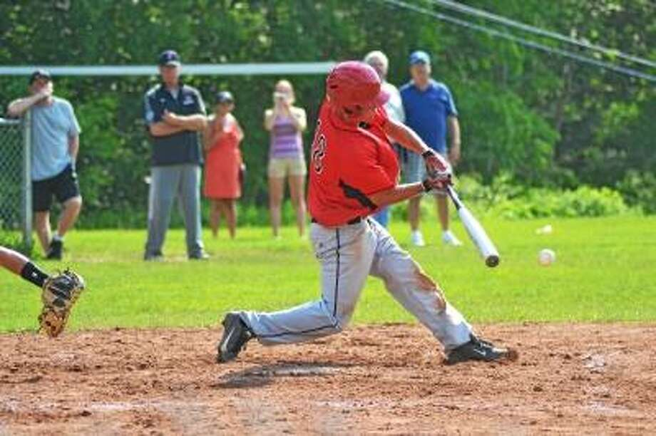 Northwestern's T.J. Kent prepares to swing at a pitch against Stonington. In the bottom ninth inning Kent ripped a bases loaded double to score two and win the game. Photo by Pete Paguaga/Register Citizen