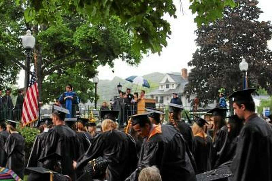 JASON SIEDZIK/Register Citizen - The 176 members of the Class of 2013 did not let a surprise storm dampen their spirits as they received their certificates and degrees Thursday evening.