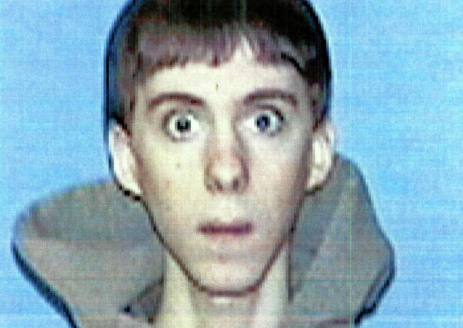 FILE - This undated file identification photo released Wednesday, April 3, 2013 by Western Connecticut State University in Danbury, Conn., shows former student Adam Lanza, who authorities said opened fire inside the Sandy Hook Elementary School in Newtown, Conn., on Friday, Dec. 14, 2012, killing 26 students and educators. Investigators released a report on the shooting Monday, Nov. 25, 2013, by the prosecutor overseeing the probe, State's Attorney Stephen Sedensky III. (AP Photo/Western Connecticut State University, File) Photo: AP / Western Connecticut State University