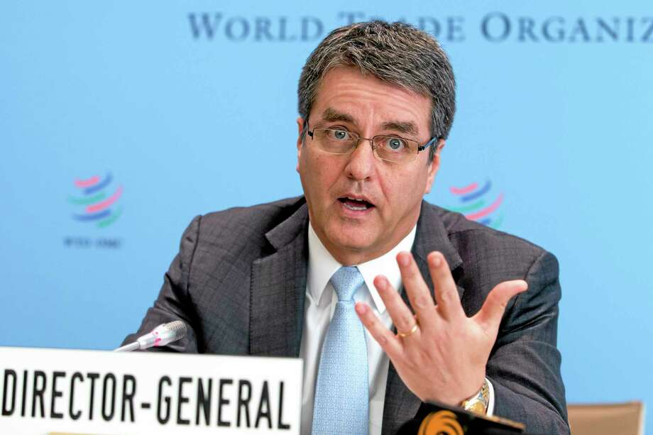 World Trade Organization, WTO, Director General Roberto Azevedo, of Brazil, informs the media about the next ministerial meeting on  Bali during a press conference, after the General Council at the headquarters of the World Trade Organization in Geneva, Switzerland, Tuesday, Nov. 26, 2013. (AP Photo/Keystone,Salvatore Di Nolfi) Photo: AP / KEYSTONE