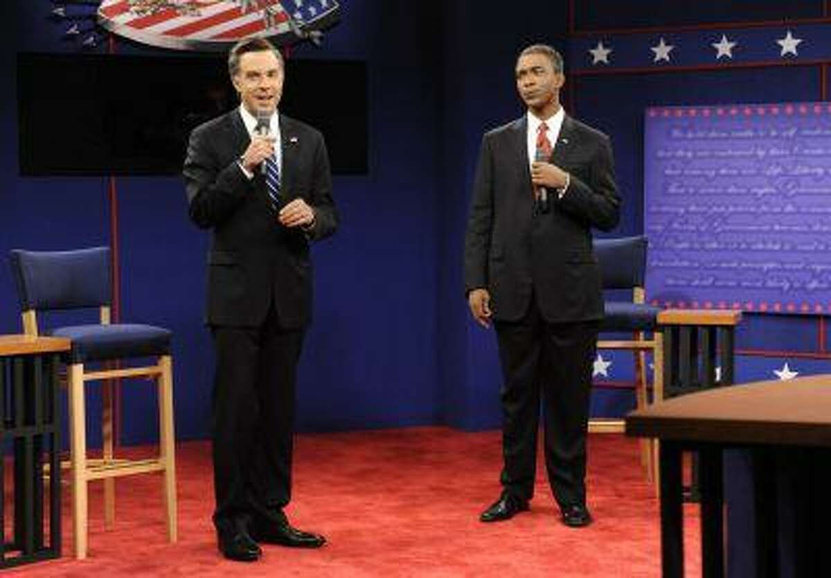 """This Oct. 20, 2012 photo released by NBC shows Jason Sudeikis portraying Republican presidential candidate Mitt Romney, left, and Jay Pharoah as President Barack Obama in a skit from """"Saturday Night Live,"""" in New York."""