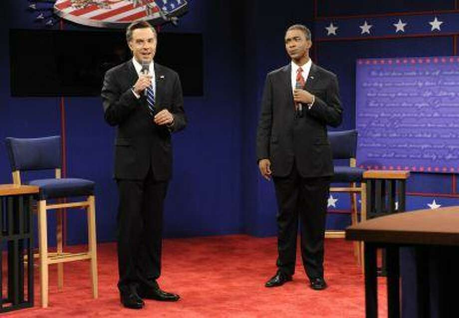 "This Oct. 20, 2012 photo released by NBC shows Jason Sudeikis portraying Republican presidential candidate Mitt Romney, left, and Jay Pharoah as President Barack Obama in a skit from ""Saturday Night Live,"" in New York. Photo: AP / NBC"