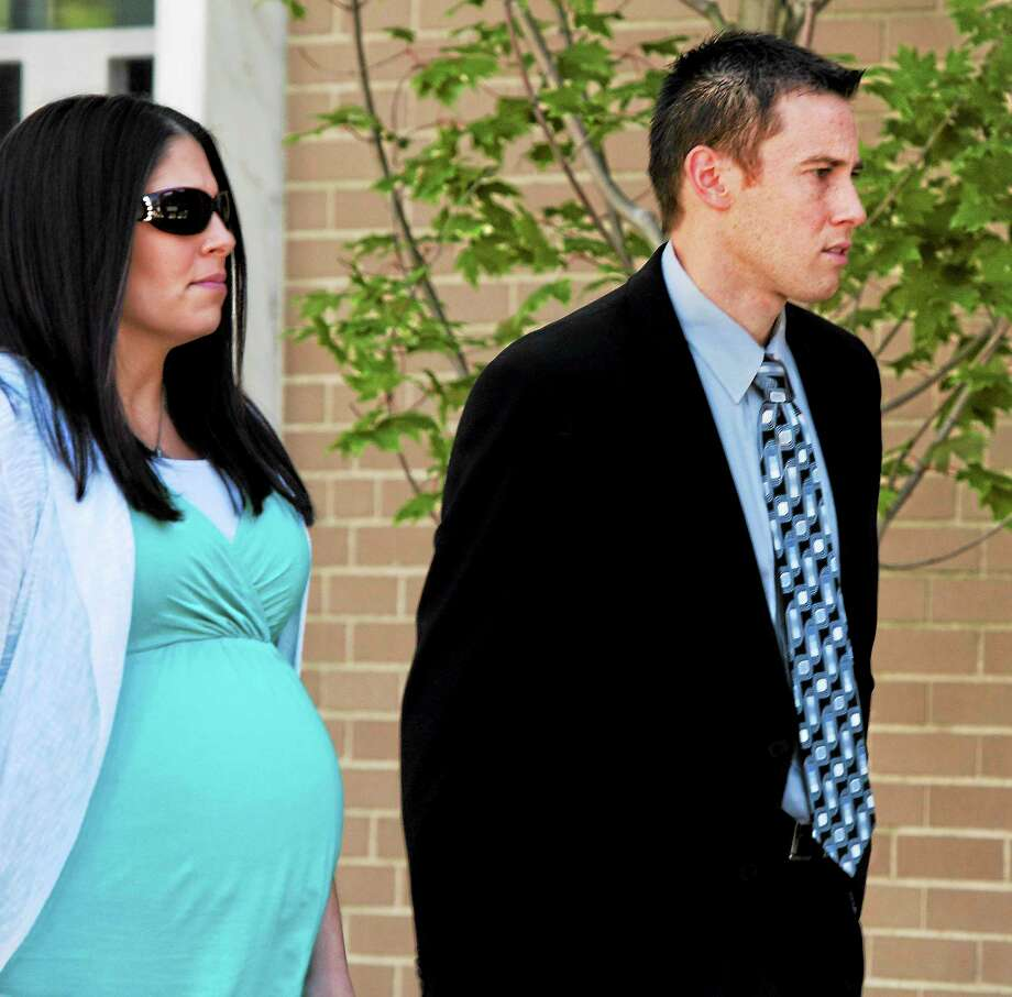 East Haven Police Officer Dennis Spaulding, right, and his wife leave court. Photo: Melanie Stengel — New Haven Register
