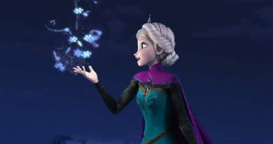 """This image released by Disney shows Elsa the Snow Queen, voiced by Idina Menzel, in a scene from the animated feature """"Frozen."""" Photo: AP / Disney"""