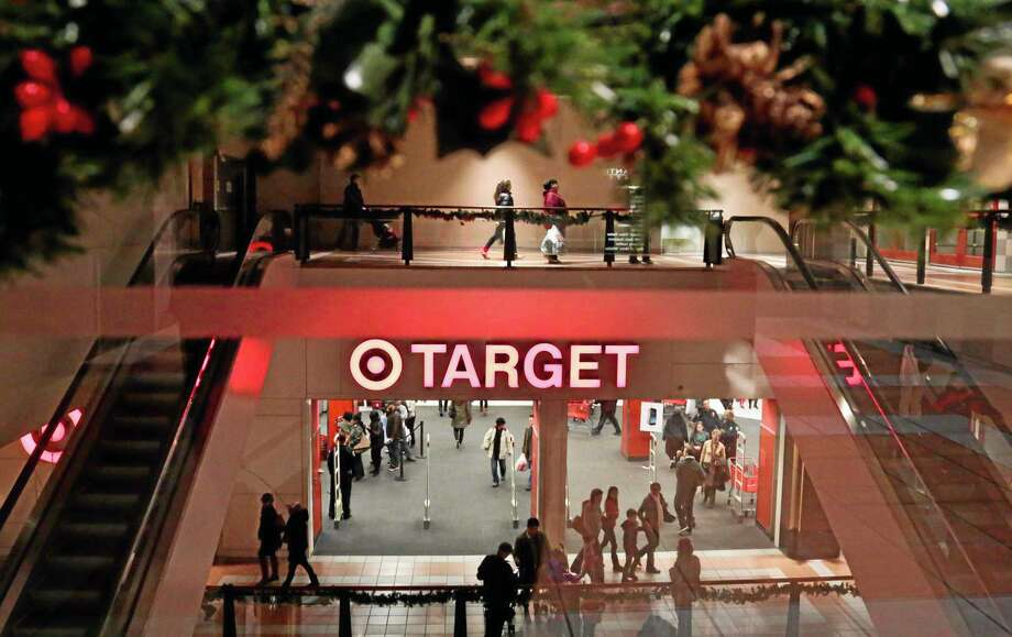 FILE - In this Saturday, Nov. 23, 2013, file photo, holiday trimmings greet shoppers around the main entry of a Target, in New York. The private Conference Board reports on consumer confidence for November on Tuesday, Nov. 26, 2013. (AP Photo/Bebeto Matthews, File) Photo: AP / AP