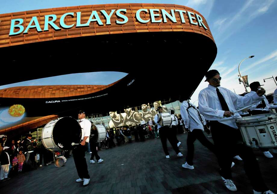 A drumline plays outside of the Barclays Center on April 20 before the start of Game 1 of the first round of the NBA Eastern Conference playoffs between the Chicago Bulls and the Brooklyn Nets in New York. The 2015 NBA All-Star weekend will be split between two New York arenas, with Madison Square Garden to host the game and the Barclays Center to host the Saturday skills events. Photo: Seth Wenig — The Associated Press   / AP