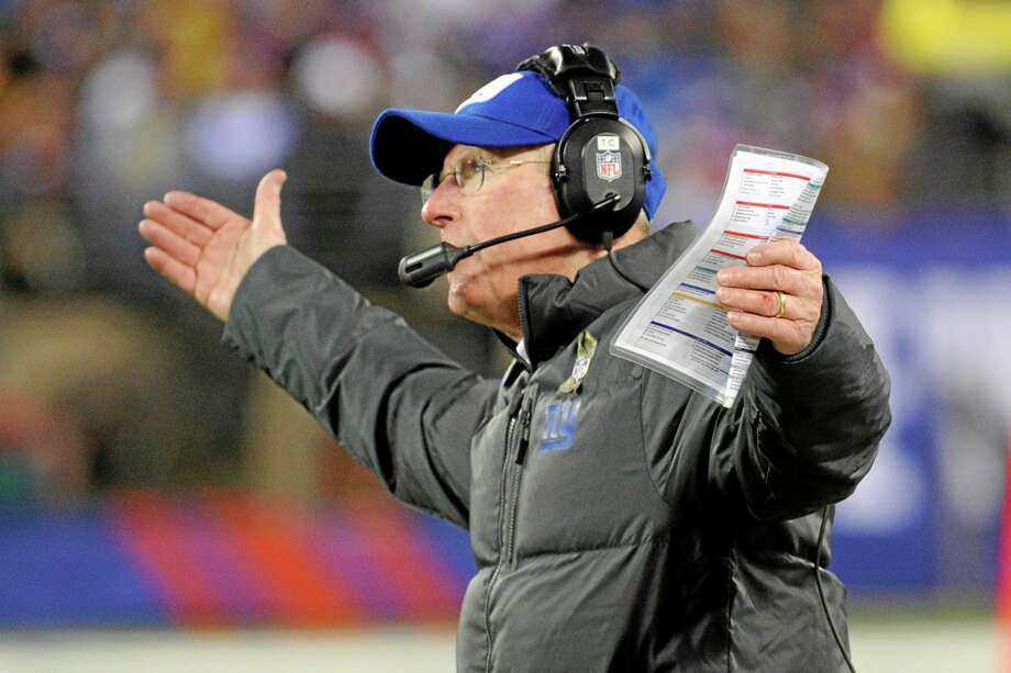 Giants head coach Tom Coughlin reacts during the first half of Sunday's game against the Cowboys. Photo: Bill Kostroun — The Associated Press   / FR51951 AP
