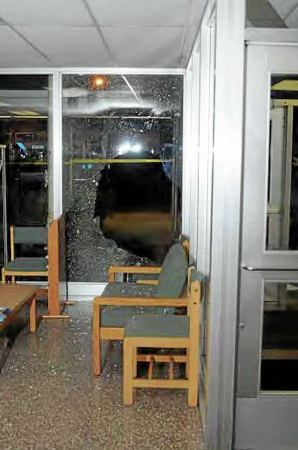 """This image contained in the """"Appendix to Report on the Shootings at Sandy Hook Elementary School and 36 Yogananda St., Newtown, Connecticut On December 14, 2012"""" and released Monday, Nov. 25, 2013, by the Danbury, Conn., State's Attorney shows a scene inside the entrance to Sandy Hook Elementary School in Newtown, Conn. Adam Lanza opened fire inside the school killing 20 first-graders and six educators before killing himself as police arrived. (AP Photo/Office of the Connecticut State's Attorney Judicial District of Danbury) Photo: AP / Office of the Connecticut State's Attorney Judicial District of"""