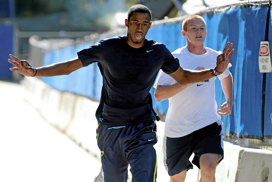 UConn's DeAndre Daniels, left, edges out teammate Pat Lenehan to be the first scholarship player to finish the 3.4 mile Husky Run for the third consecutive year on Wednesday in Storrs. Photo: Jessica Hill — The Associated Press   / FR125654 AP