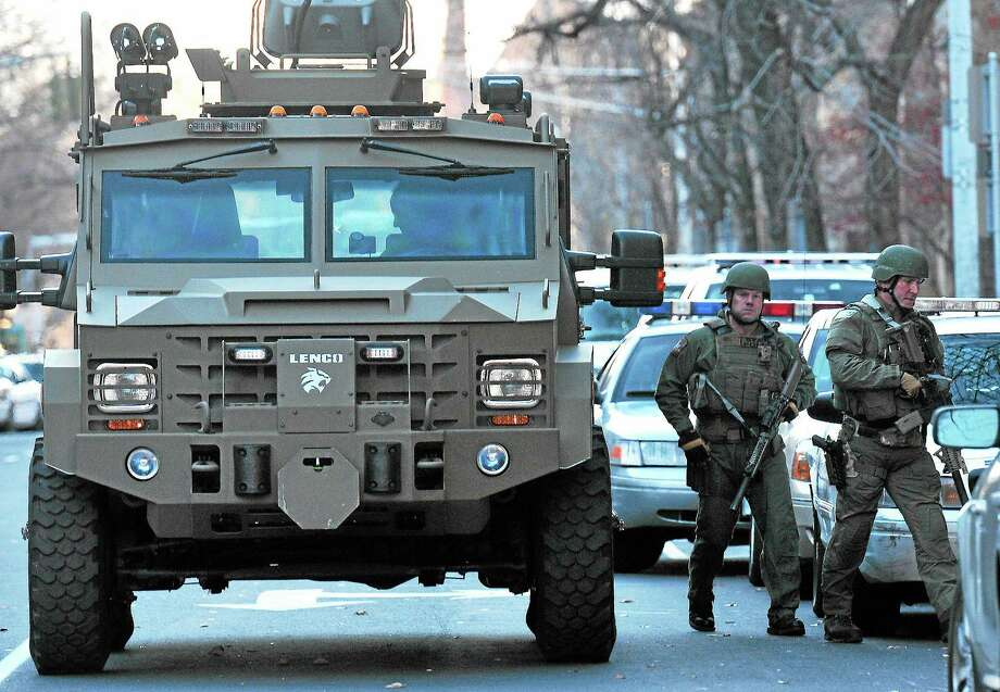 (Peter Casolino — New Haven Register)   SWAT teams prepare to search more of Old Campus during the Yale lockdown Monday afternoon. pcasolino@NewHavenRegister Photo: Journal Register Co.