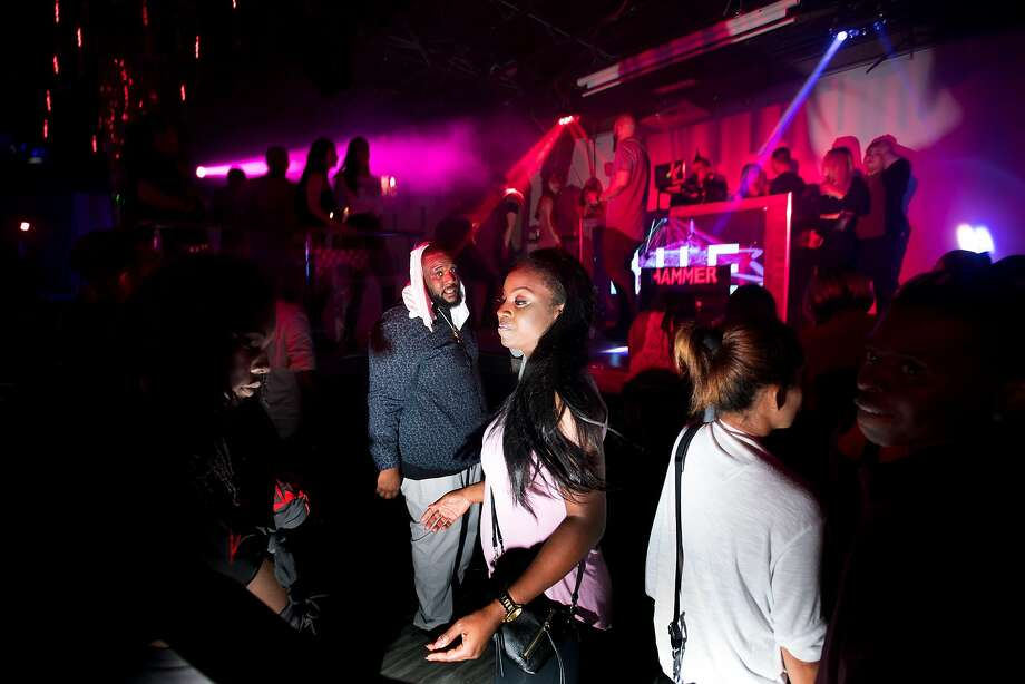 Allie Arnold dances at Hue Lounge and Nightclub in the early hours of Sunday, July 23, 2017, in San Francisco. The owner of the North Beach nightclub says that police and neighbors unfairly target the club. Photo: Noah Berger, Special To The Chronicle