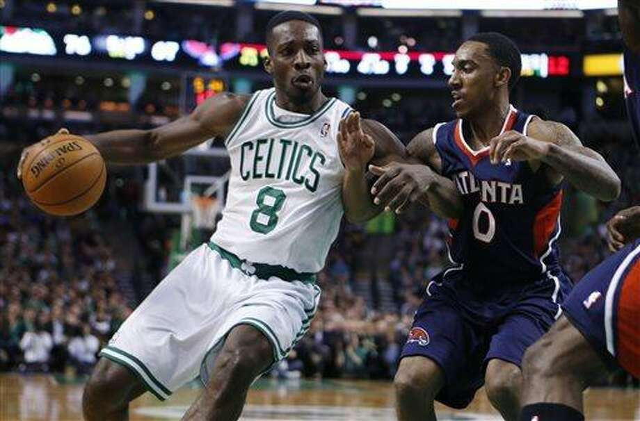 Boston Celtics' Jeff Green (8) drives against Atlanta Hawks' Jeff Teague (0) during the third quarter of an NBA basketball game in Boston, Friday, March 29, 2013. The Celtics won 118-107. (AP Photo/Michael Dwyer) Photo: ASSOCIATED PRESS / AP2013