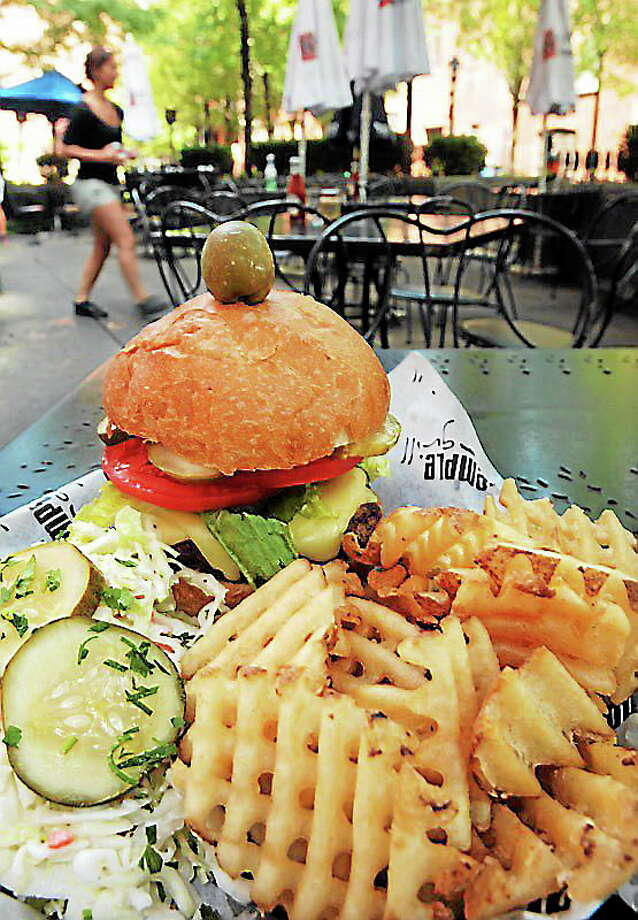 (Mara Lavitt — New Haven Register) August 27, 2013 Temple Grill. The Temple Burger is made with 10 oz. of USDA choice ground beef served with cole slaw, pickle, and here with waffle fries. Photo: Journal Register Co. / Mara Lavitt