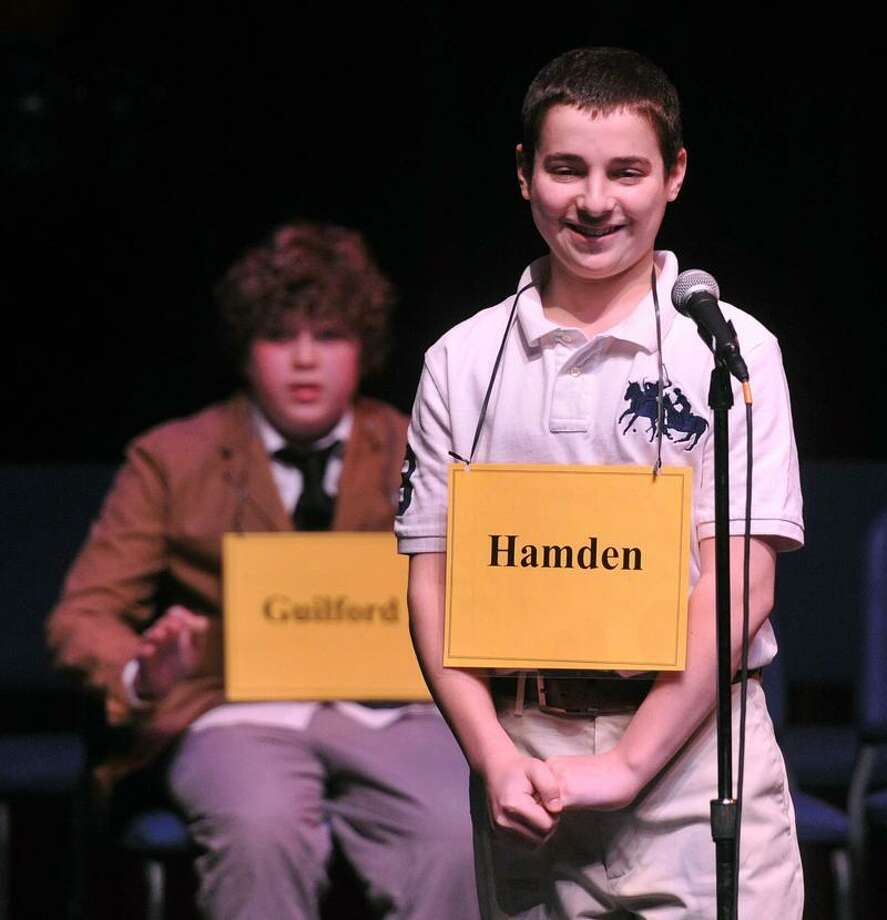 Anthony Capasso, 13, from Hamden Hall, smiles as he wins the New Haven Register Spelling Bee at SCSU's Lyman Hall. Anthony is in Washington D.C. competing in the national spelling bee.  Photo-Peter Casolino/Register