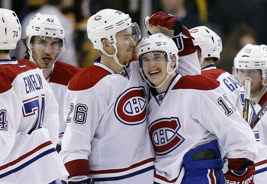 Montreal Canadiens' Brendan Gallagher (11) celebrates with teammate Josh Gorges (26) after scoring the winning goal in a shootout during an NHL hockey game against the Boston Bruins in Boston, Wednesday, March 27, 2013. The Canadiens won 6-5. (AP Photo/Michael Dwyer) Photo: AP / AP