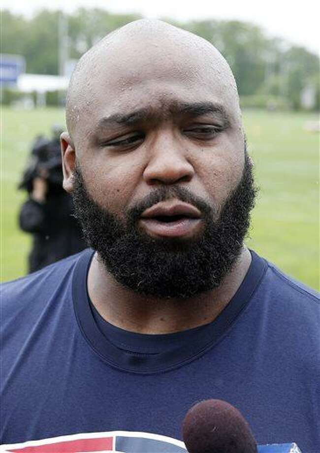 New England Patriots defensive end Tommy Kelly talks with reporters after NFL football practice in Foxborough, Mass., Wednesday, May 29, 2013. (AP Photo/Michael Dwyer) Photo: AP / AP