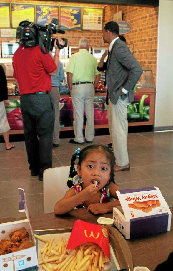 (Melanie Stengel — New Haven Register )    Zana Lopez,2, of West Haven, eats lunch at the newly reopened rest stop on I-95, in Branford 9/25.  She was there with her family, to see friends who work at the rest stop. Photo: Journal Register Co.