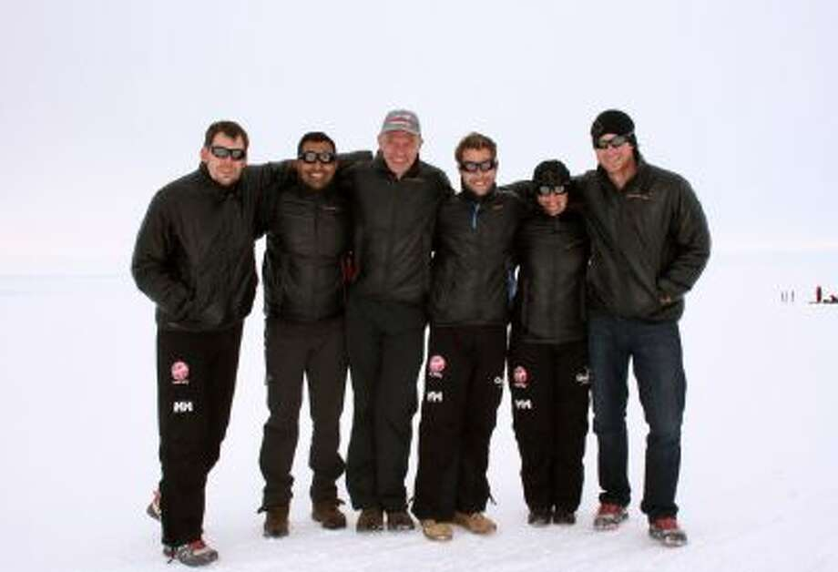 In this Friday, Nov. 22, 2013 photo made available by Walking with the Wounded (WWTW), Britain's Prince Harry, partron of the UK team, right, poses with team members from right, Kate Philp, Guy Disney, Richard Eyre, Ibrar Ali and Duncan Slater in Novo, Antarctica , prior to the start of the South Pole Allied Challenge 2013 expedition.