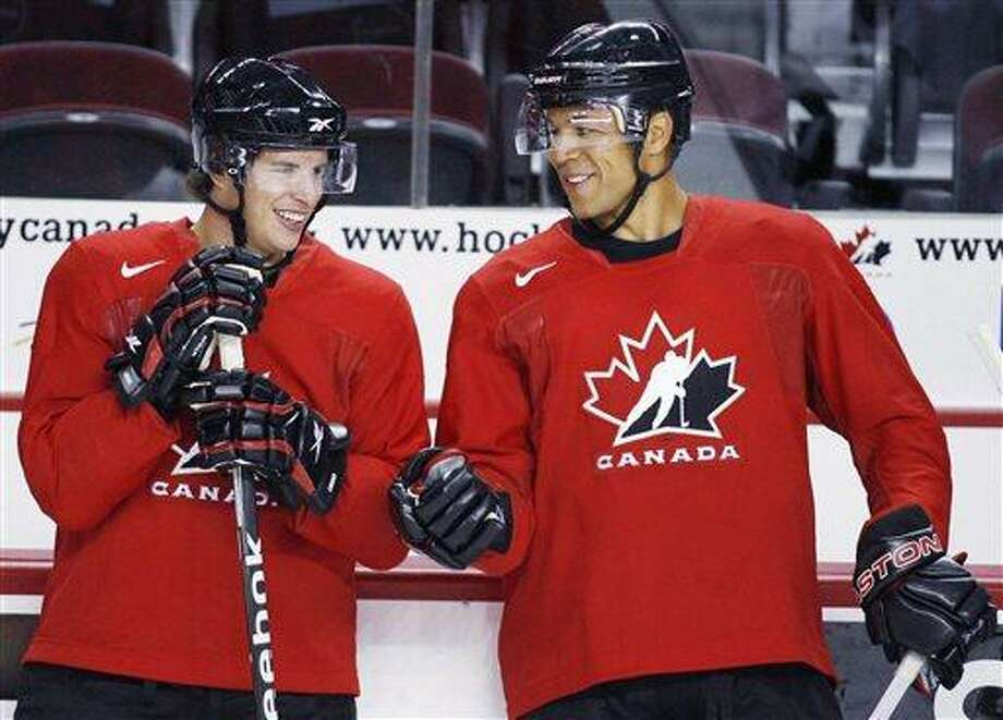 Sidney Crosby, left, and Jarome Iginla, chat during a practice at the Men's National Olympic Hockey Team orientation camp in Calgary, Tuesday, Aug. 25, 2009. The Calgary Flames Hockey Club have traded team captain Jarome Iginla in exchange for forwards Kenneth Agostino and Ben Hanowski and the Pittsburgh Penguins 2013 first round pick. (AP Photo/The Canadian Press, Fred Chartrand, file) Photo: AP / The Canadian Press