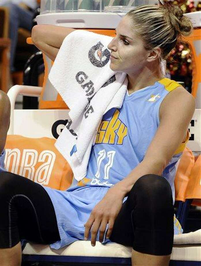 FILE - In this July 12, 2013, file photo, Chicago Sky's Elena Delle Donne sits on the the bench during the first half of a WNBA basketball game against the Connecticut Sun in Uncasville, Conn. Delle Donne will miss the WNBA All-Star game on Saturday while recovering from a concussion. The No. 2 pick in the draft was injured in the Sky's loss to Washington on Wednesday when she was going for a loose ball with a minute left in the third quarter.  (AP Photo/Jessica Hill, File) Photo: AP / FR125654 AP