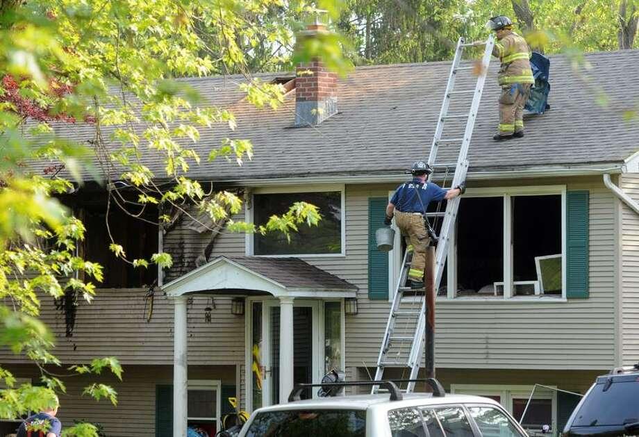 "Fire aftermath at 69 Wayne Rd. Milford.  Mara Lavitt/New Haven Register <a href=""mailto:mlavitt@newhavenregister.com"">mlavitt@newhavenregister.com</a>5/29/13"
