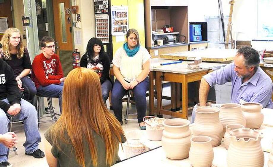 Photo Courtesy OHS Potter Dean White, owner of Whites Pottery in Deansboro, demonstrates various pottery wheel throwing techniques to students in December.