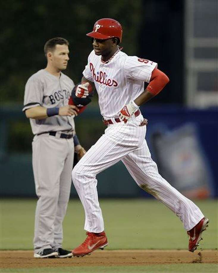 Philadelphia Phillies' Domonic Brown, right, rounds the bases past Boston Red Sox shortstop Stephen Drew after hitting a home run in the fourth inning of a baseball game, Wednesday, May 29, 2013, in Philadelphia. (AP Photo/Matt Slocum) Photo: AP / AP