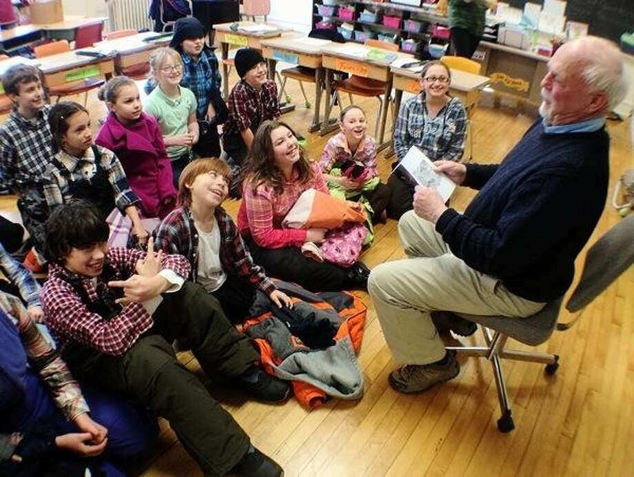 """Dispatch Staff Photo by JOHN HAEGER (Twitter: @OneidaPhoto) Author Richard Mickelson reads from his latest novel """"The Wizard of Oz: Where is He Now?""""  to St. Patrick's Elementary School students on Tuesday in Oneida."""