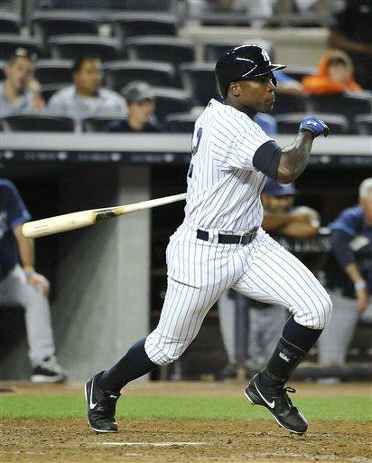 New York Yankees' Alfonso Soriano watches his single off Tampa Bay Rays relief pitcher Cesar Ramos in the eighth inning of a baseball game at Yankee Stadium on Friday, July 26, 2013, in New York. (AP Photo/Kathy Kmonicek) Photo: AP / FR170189 AP